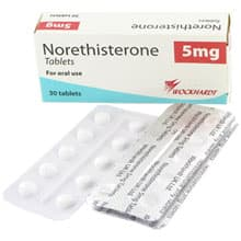 Box of Norethisterone tablets with blister strips
